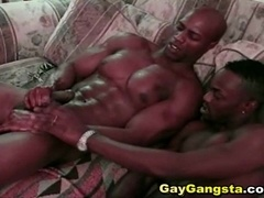 Two black guys are fucking each other on the couch