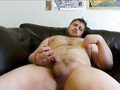 Beefy bear stroking on cauch