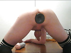 Kitchen sissy fucks huge buttplug and cums with fleshlight