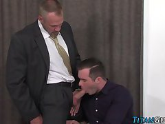 Suited gay cum splattered