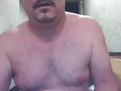 JoeyD posing naked with Hitachi on balls and curvy butt