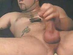 Hot muscular guy enjoying it with a toy