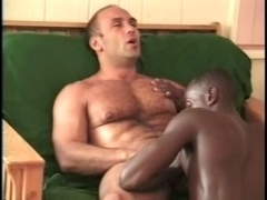 Black lad and a muscular gay daddy enjoy sucking each other's cocks