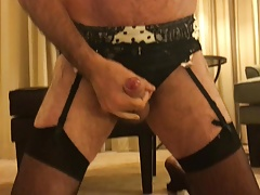 Crossdressing in sexy stockings cums in hotel