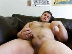 Beefy bear stroking on cauch