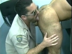Muscular gay bear blows and gets fucked from behind in a jail