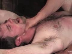 Bulky stud gets bound by his BF and enjoys his cock in his mouth and ass