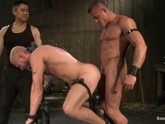 Bald gay gets tormented and fucked by two hunks in a basement