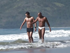 Ebony stud with six pack rides partner's cock in the sand