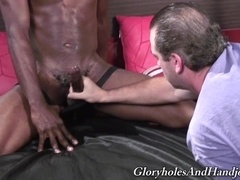 A lewd gay daddy gives a handjob to some horny black stud