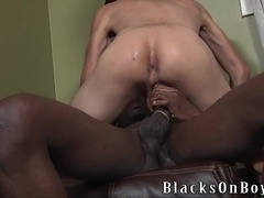 Two black gays fuck a horny twink's mouth and ass indoors
