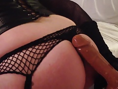 Crossdresser in black outfit fuck her dildo using doggystyle
