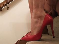 Cumming in red heels