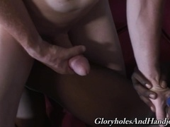 Redhead daddy gives a handjob to a black lad and jerks his dick off