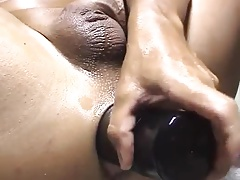 Preparing for a fist session with a big dildo