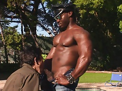 Eager boy sucks black dick on his knees by the pool