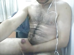 HAIRY LATINO CUB SPRAYS CUM ON HIS BELLY