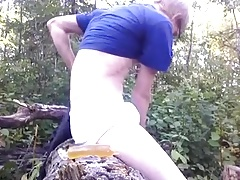 Young Blond Boy Fun in the Forest