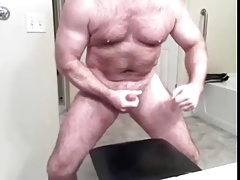 bear cumming and posing