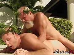Bearded mature bear enjoys drilling that young tight bum