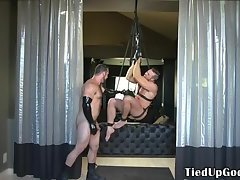 Gagging BDSM sub flogged by spandex gay