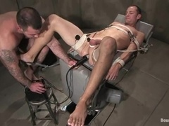 Dak Ramsey gets whipped and enjoys a wired dildo in his asshole