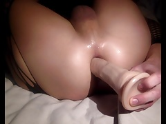 Amateur playing with his dildo and stroking his cock