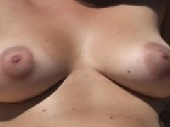 Hot busty woman Nude about the Seaside