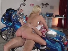 A blonde that has a sexy ass is getting her pussy licked on the bike