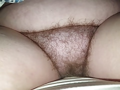 wifes hairy bush sitting on the bed