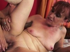 Redhead granny fucks and cumplays