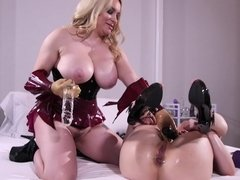 A blonde dominates her brunette lesbian friend with sex toys