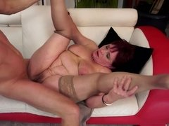 A big old granny redhead with large saggy tits is getting rammed