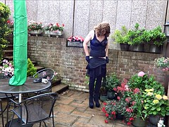 Wanking and plugged in the garden in Thigh High Boots