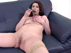 Mature brunette undressing and pleasuring herself