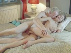 A blonde with a nice rack is fucked hard from behind