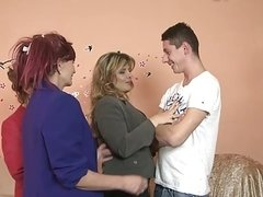 Three women fuck with a guy