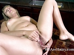 Christal masturbates after stripping nude on table
