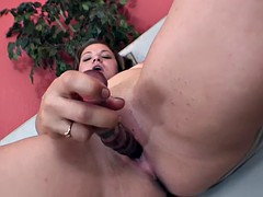 Slutty brunette teases her shaved pussy with a dildo