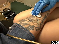 Beautiful tattoo artist satisfying a lucky client