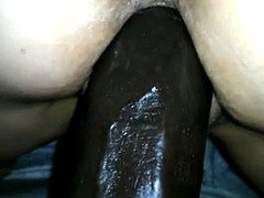 Trying to fuck her huge (for her) black dildo