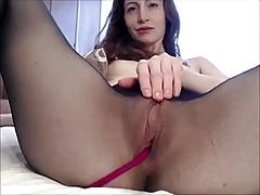 Girl in seamless pantyhose brings herself to orgasm