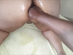 Stuffing her gaping asshole