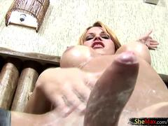 Shemale enjoys massive ass fingering and shecock cum milking