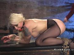 Gagged blonde gets fistied and squirts