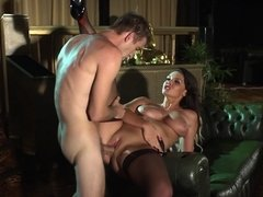 A fine woman that has huge tits is sucking a cock and she is riding one
