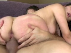 A girl with a pretty mouth is siting and riding on a big cock