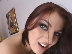 Young-looking redhead chick in fishnet pantyhose swallowing