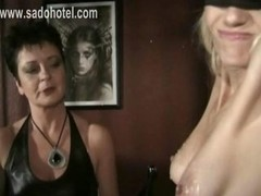 Blond slave with nice tits and burning candle in her tight cunt gets herself covered in hot candle wax