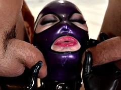 Big boobs bitch in rubber suit takes two cocks in her tight hole